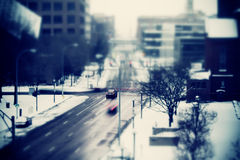 Snowy Traffic Blue. A tilt shift shot of snowy traffic at an intersection with a blue tint and blur Royalty Free Stock Images