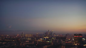 Tilt shift time lapse of sunset in big summer city stock video