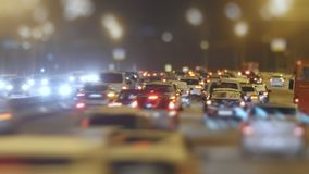 Tilt Shift Time Lapse Traffic on snow winter highway. Telephoto shot stock video footage