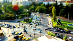 Tilt shift time lapse video of an intersection in central Athens, during rush hour stock footage