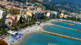 Tilt-shift view of the beach in Menton, France Royalty Free Stock Photo