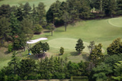 Tilt-shift view of golf course. Picture of golf course with tilt-shift effect Stock Photo
