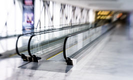 Tilt-shift view of horizontal escalator Royalty Free Stock Images