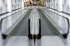 Tilt-shift view of horizontal escalator Stock Image
