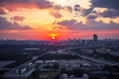 Tilt and shift view of sunset panorama of Moscow with red clouds and sun disk Stock Image