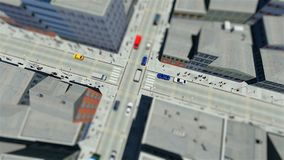 Tilt shift of walking people and traffic in the city. 3D stock video footage