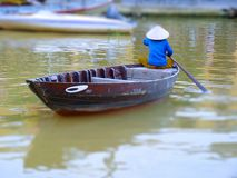 Tilt Shift Of A Woman On Her Boat Royalty Free Stock Images