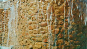Tilt shot: Decorative waterfall. Landscaping of houses and hotels stock footage