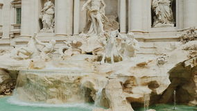 Tilt shot: Trevi Fountain in Rome. Popular place among tourists from all over the world. 4K 10 bit video. The famous Trevi Fountain in Rome. Popular place among stock video footage
