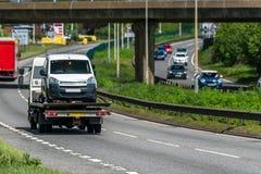 Tilt trailer truck on uk motorway in fast motion.  stock photos