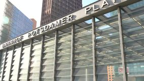 Day time video of people and passengers outside Potsdamer Platz Station, Berlin, Germany stock video footage