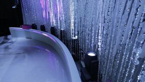 Tilt up of beautiful brilliant beaded curtain with great lighting stock video footage