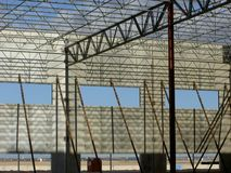 Tilt-up Concrete / Structural Steel Building. Tilt-up wall panels are seen w/ the wall braces in place as the structural steel roof joist system is installed stock photos