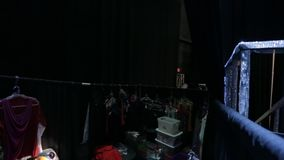 Tilt up from Dressing Room backstage to Lights in Ceiling stock video footage