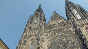 Tilt up panoramic view from blue sky to ancient gothic church St Vitus cathedral in Prague. In sunny day stock video