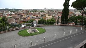 Tilt up Rome skyline. Tilt up aerial view of Rome skyline in Italy, From Pincio hill with San Pietro,Saint Peter basilica, and Trinita dei Monti road stock video