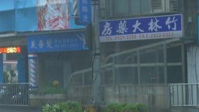 Tilt up to debri in poles typhoon megi during Typhoon Wind and Raintennis table. New Taipei City, Taiwan.  September 27, 2016: Tilt up to debri in poles on city stock video footage