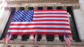 Tilt up view of the exterior of the Stock Exchange on Wall Street. In New York City stock footage