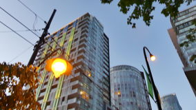 Tilt Vancouver Canada downtown evening. Highrise buildings road lantern dusk Canada stock video footage