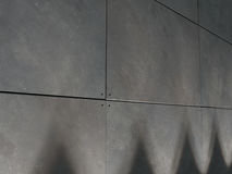 Tiltcrete Wall Base Spotlit. A contemporary tiltcrete wall lit from the base with spotlights at night Royalty Free Stock Photo