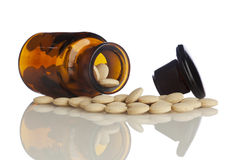 Tilted bottle of pills Royalty Free Stock Images