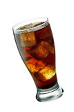Tilted glass of cola. Including ice cubes Stock Images