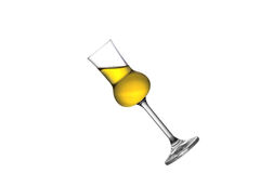 Tilted Grappa. A tilted full grappa glass isolated on white Stock Photos