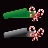 Tilted green and gray banners with candy canes Stock Image
