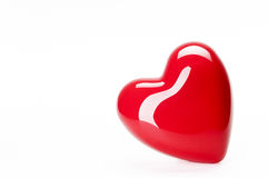 Tilted heart. A red heart tilted to the left on a white background Royalty Free Stock Photos