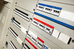 Electricity Distribution Control. Tilted horizontal view of an industrial level main electricity cabinet, with all the power switches to the different areas stock photos