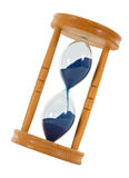 Tilted hourglass - isolated. Tilted hourglass with blue sandgrains measuring time - isolated Stock Photos