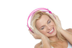 Tilted shot of a blonde engrossed in music Stock Images