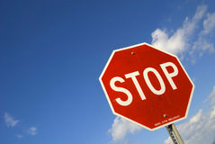 Tilted Stop Sign. At road junction Stock Photography