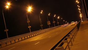 Tilted time-lapse driving cars, night city highway yellow lights. Stock footage stock video