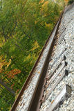 Tilted Tracks. Train tracks, running tilted through autumn stock photo