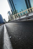 Vacant Urban Street. Tilted view diminishing perspective of a downtown urban street empty of traffic Stock Images