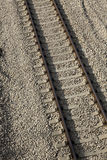 Tilted Railroad. Tilted view of part of a railroad track on gravel Stock Image