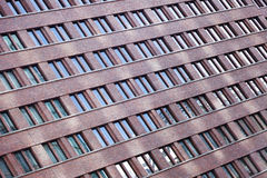 Tilted Building Windows Pattern. Tilted view at the pattern of windows on a tall building Stock Image