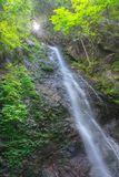 Tilted, Hossawa Waterfalls in Hinohara. Tilted view of waterfall in the forest, the Hossawa falls in Hinohara village. Tokyo, Japan Royalty Free Stock Photography