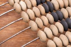 Wooden abacus fragment. Tilted vintage wooden abacus fragment with focus on beads Stock Images