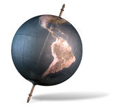 Tilted World Globe. A vintage world globe tilted and standing on a central axis on an isolated white background Royalty Free Stock Photo
