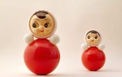 Tilting dolls Stock Image