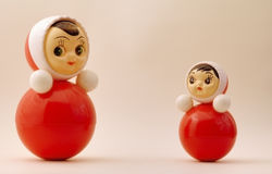 Tilting dolls Royalty Free Stock Images
