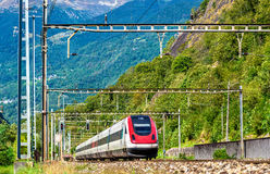 Tilting high-speed train on the Gotthard railway. The traffic will be diverted to the Gotthard Base Tunnel in December 2016 Stock Photo