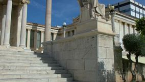 Statue of the Greek philosopher Socrates. Tilting view of the statue of the Greek philosopher Socrates in front of the National Academy of Athens, Greece stock footage