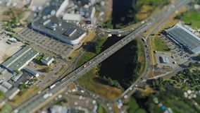 Road cars traffic bridge drone timelapse viaduct in Riga city miniature in motion stock footage