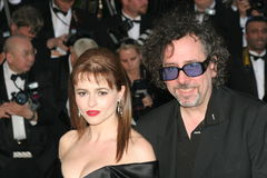 Tim Burton and wife Helena Bonham Carter. CANNES, FRANCE - MAY 19: Tim Burton and wife Helena Bonham Carter attend the 'Volver' premiere at the Palais des Stock Image