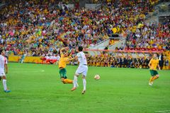 Tim Cahill Being Fouled Stockfotos