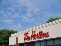 Tim Hortons tecken på byggnad royaltyfri foto