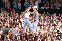 Tim McGraw & Kenny Chesney. Tim McGraw & Kenny Chesney perform live in Chicago for the Brothers of the Sun Tour Royalty Free Stock Photos